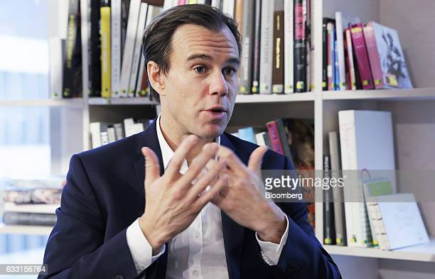 KarlJohan Persson chief executive officer of Hennes Mauritz AB gestures as he speaks during an interview following a news conference in Stockholm...