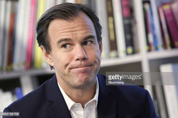 KarlJohan Persson chief executive officer of Hennes Mauritz AB reacts during an interview following a news conference in Stockholm Sweden on Tuesday...
