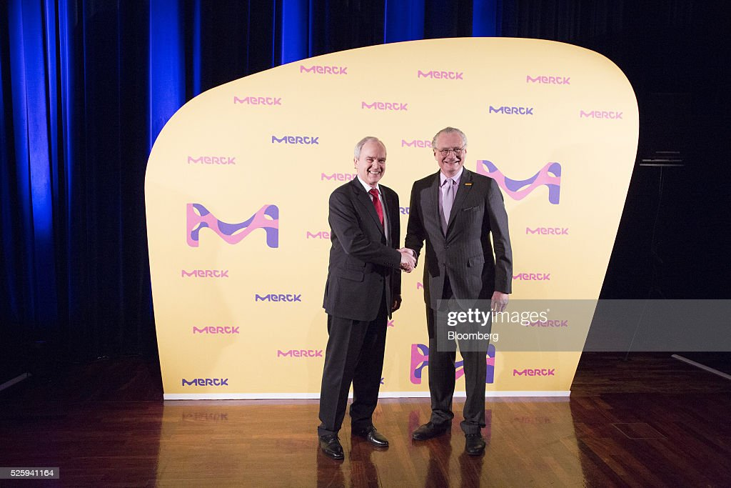 Karl-Ludwig Kley, chief executive officer of Merck KGaA, left, and Stefan Oschmann, deputy chief executive officer of Merck KGaA, pose for a photograph during the pharmaceutical company's annual general meeting in Frankfurt, Germany, on Friday, April 29, 2016. Kley will replace Werner Wenning as chairman of the supervisory board of EON SE after the company's annual general meeting on June 8, EON said. Photographer: Martin Leissl/Bloomberg via Getty Images