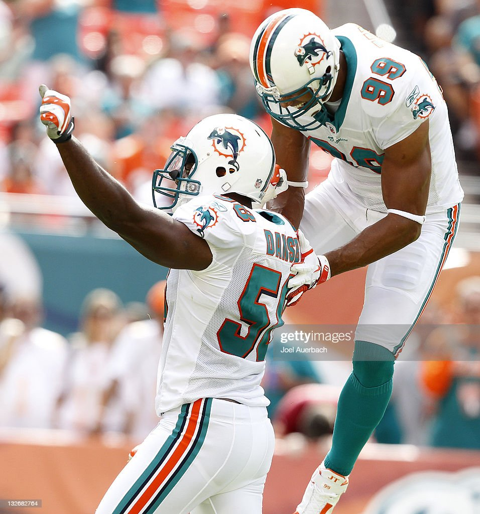 <a gi-track='captionPersonalityLinkClicked' href=/galleries/search?phrase=Karlos+Dansby&family=editorial&specificpeople=233759 ng-click='$event.stopPropagation()'>Karlos Dansby</a> #58 is congratulated by Jason Taylor #99 of the Miami Dolphins after he sacked Rex Grossman #8 (not pictured) of the Washington Redskins on November 13, 2011 at Sun Life Stadium in Miami, Florida.