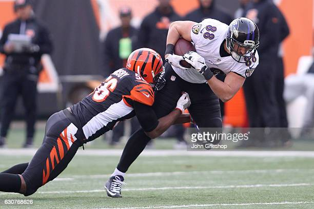 Karlos Dansby of the Cincinnati Bengals tackles Dennis Pitta of the Baltimore Ravens during the third quarter at Paul Brown Stadium on January 1 2017...