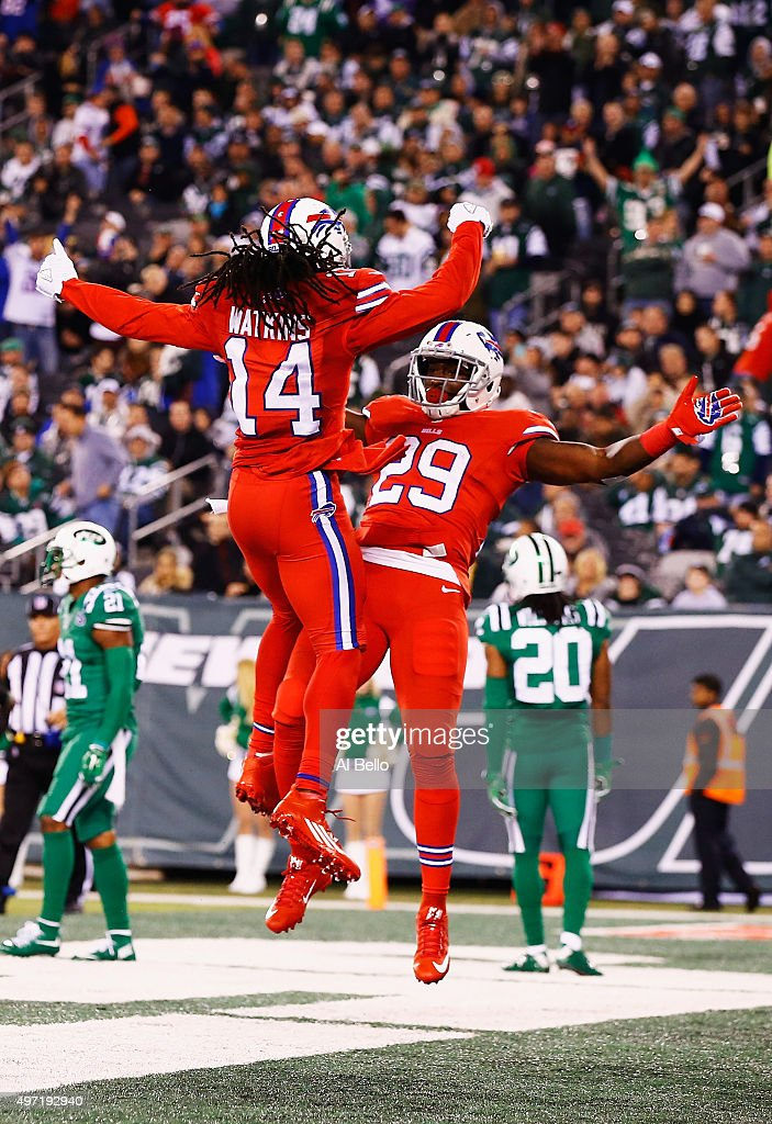 Karlos Williams #29 of the Buffalo Bills is congratulated by his teammate Sammy Watkins after scoring a third quarter touchdown against the New York Jets at MetLife Stadium on November 12, 2015 in East Rutherford, New Jersey.