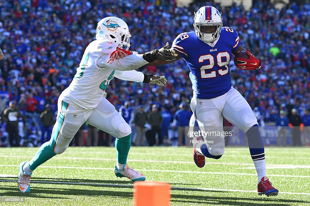 <a gi-track='captionPersonalityLinkClicked' href=/galleries/search?phrase=Karlos+Williams+-+American+Football+Player&family=editorial&specificpeople=8572128 ng-click='$event.stopPropagation()'>Karlos Williams</a> #29 of the Buffalo Bills runs with the ball as <a gi-track='captionPersonalityLinkClicked' href=/galleries/search?phrase=Jelani+Jenkins&family=editorial&specificpeople=5653455 ng-click='$event.stopPropagation()'>Jelani Jenkins</a> #53 of the Miami Dolphins defends during the second quarter at Ralph Wilson Stadium on November 8, 2015 in Orchard Park, New York. Buffalo defeated Miami 33-17.