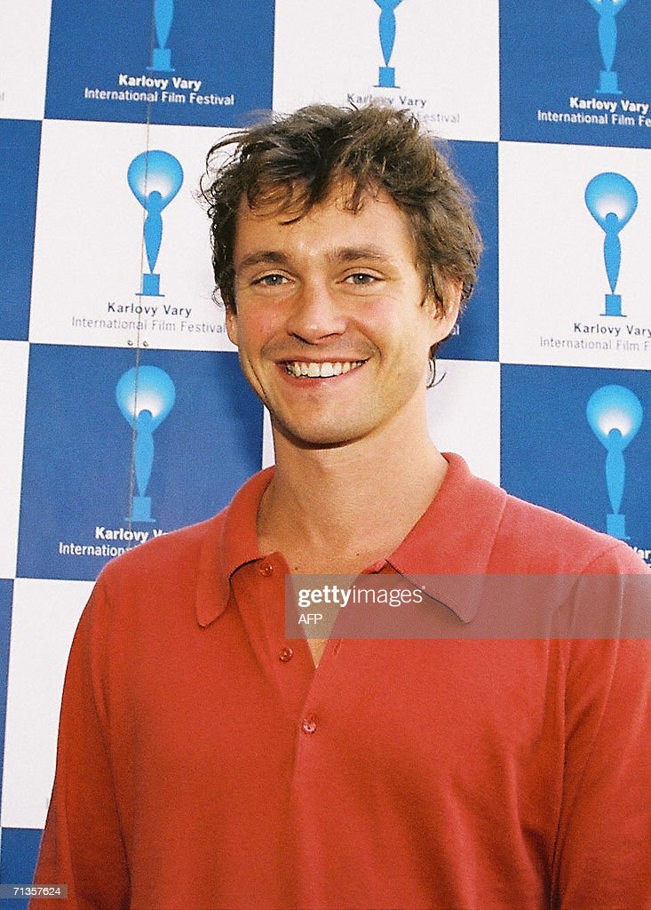 British actor and director Hugh Dancy smiles 02 July 2006 during a photo call at the 41st Karlovy Vary International Film Festival (Carlsbad-KVIFF) before the screening of his latest movie 'Shooting Dogs'. This British actor is one of the UK's most up and coming talents. He first got started with roles in series such as Trial & Retribution II (1998) (TV), 'Dangerfield' (1995), 'Kavanagh QC' (1995) and Granada's popular series 'Cold Feet' (1997) and his theater appearances include Sam Mendes's David Copperfield (2000) (TV) and BBC's Madame Bovary (2000) (TV). The 41st KVIFF will present over 230 features, including 15 world premieres and 39 European or international premieres, from 30 June to 08 July.