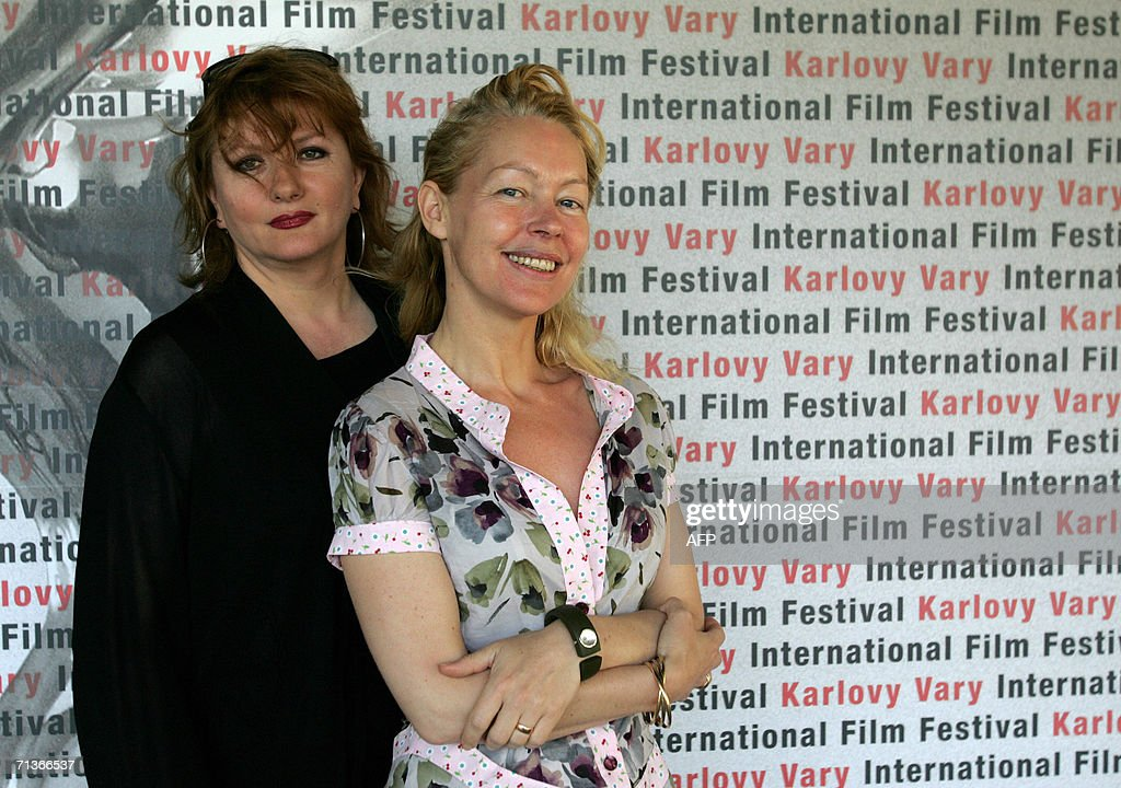 French director Virginie Wagon (R) and French actress Catherine Jacob pose 04 July 2006 in Karlovy Vary (Carlsbad) during the 41st Karlovy Vary International Film Festival (KVIFF) before the screening of their latest movie 'This Girl Is Mine' ('L'enfant d'une autre'). The 41st KVIFF will present over 230 features, including 15 world premieres and 39 European or international premieres, from 30 June to 08 July.
