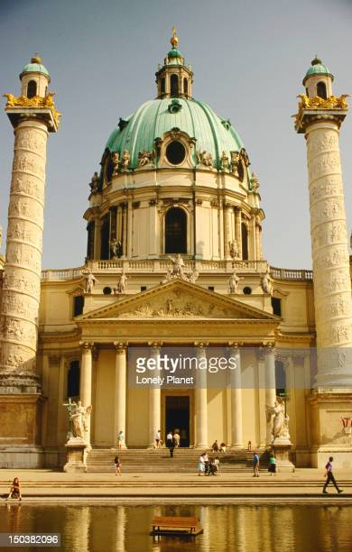 Karlskirche ( St Charles' Church ) is predominately baroque although the twin columns are modelled on the Trojan's Column in Rome, Vienna