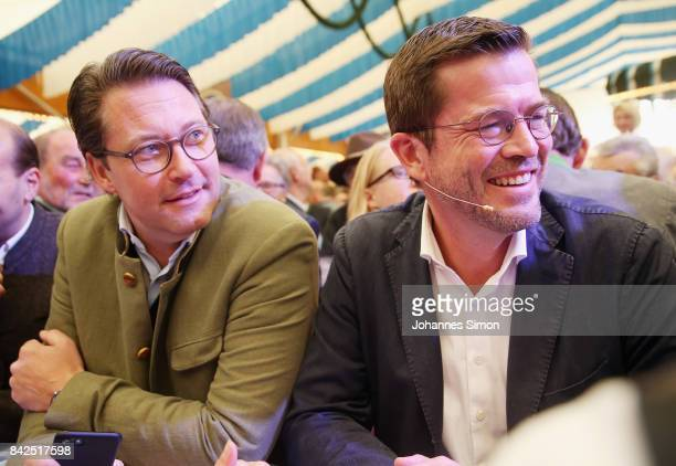 KarlTheodor zu Guttenberg of the Christlich Soziale Union looks on in a fest tent beside of CSU general secretary Andreas Scheuer at the Gillamoos...