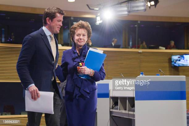 KarlTheodor zu Guttenberg stands next to European Commissioner for the Digital Agenda Neelie Kroes upon his arrival to speak at the launch of a...