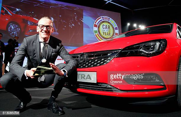 KarlThomas Neumann CEO of Opel Group poses next to an Opel / Vauxhall Astra model after it was awarded the 'European Car of the Year 2016' title...