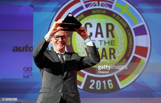 KarlThomas Neumann CEO of Opel Group shows the 'European car of the year ' award for the Opel / Vauxhall Astra model on February 29 2016 in Geneva...