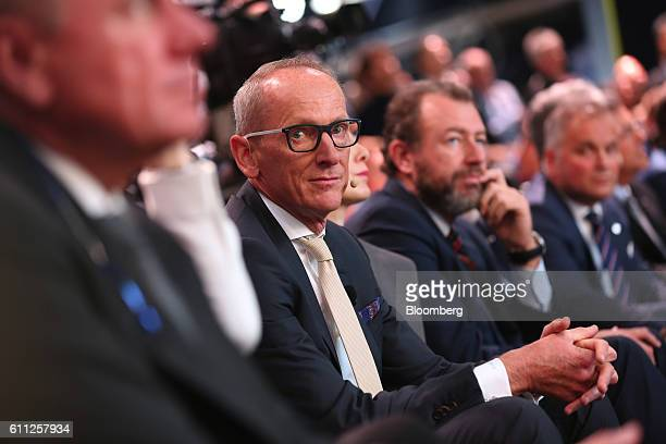 KarlThomas Neumann chief executive officer of Adam Opel AG center looks on as he sits in the audience on the first press day of the Paris Motor Show...
