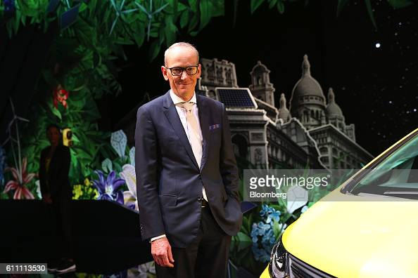 KarlThomas Neumann chief executive officer of Adam Opel AG poses for a photograph ahead of an interview on the first press day of the Paris Motor...