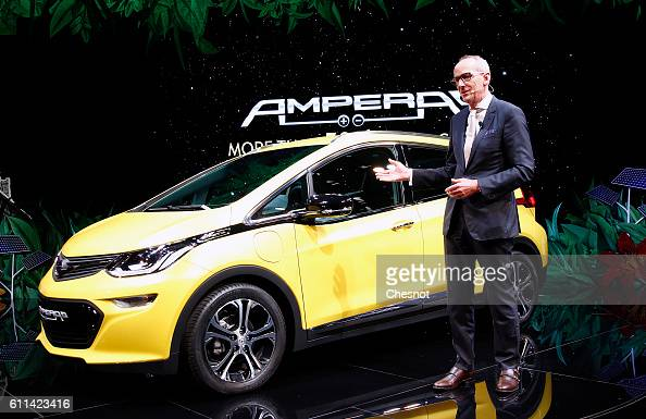 KarlThomas Neumann chief executive officer of Adam Opel AG speaks on stage as he presents a new Opel Ampera electric automobile during the press day...