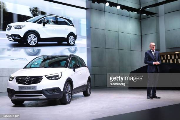 KarlThomas Neumann chief executive officer of Adam Opel AG speaks on stage as he unveils the Opel Crossland X sports utility vehicle on the first day...