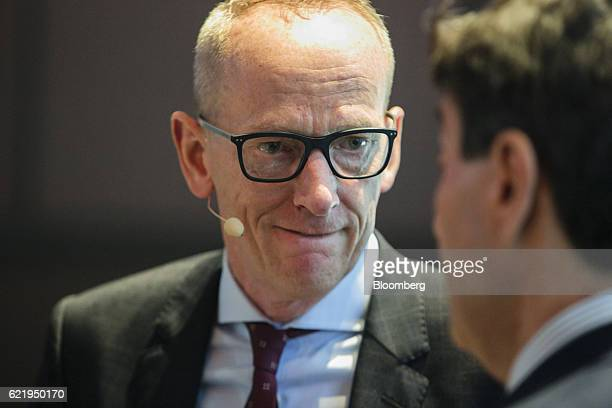 KarlThomas Neumann chief executive officer of Adam Opel AG speaks to an attendee at the Handelsblatt Automotive Summit in Munich Germany on Wednesday...