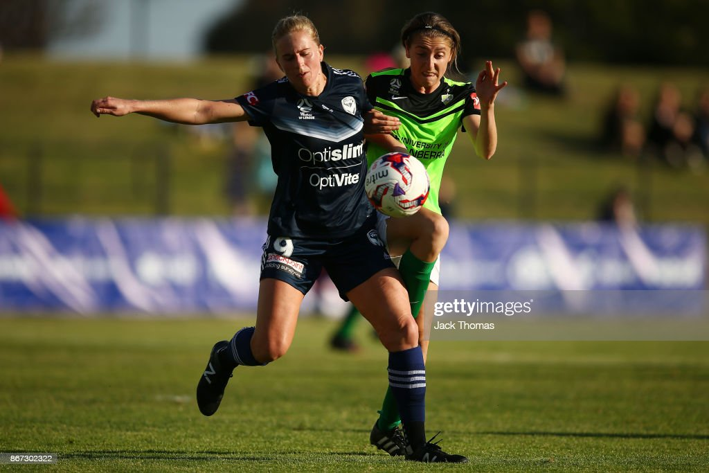 Karly Reostbakken of Canberra (R) and Natasha Dowie of the Victory compete for the ball during the round one W-League match between Melbourne Victory and Canberra United at Epping Stadium on October 28, 2017 in Melbourne, Australia.