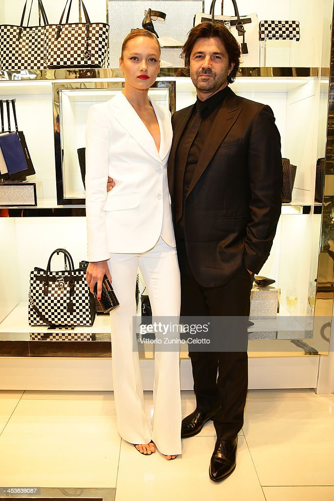 Karmen Pedaru and Riccardo Ruini attend Michael Kors To celebrate Milano opening on December 4, 2013 in Milan, Italy.