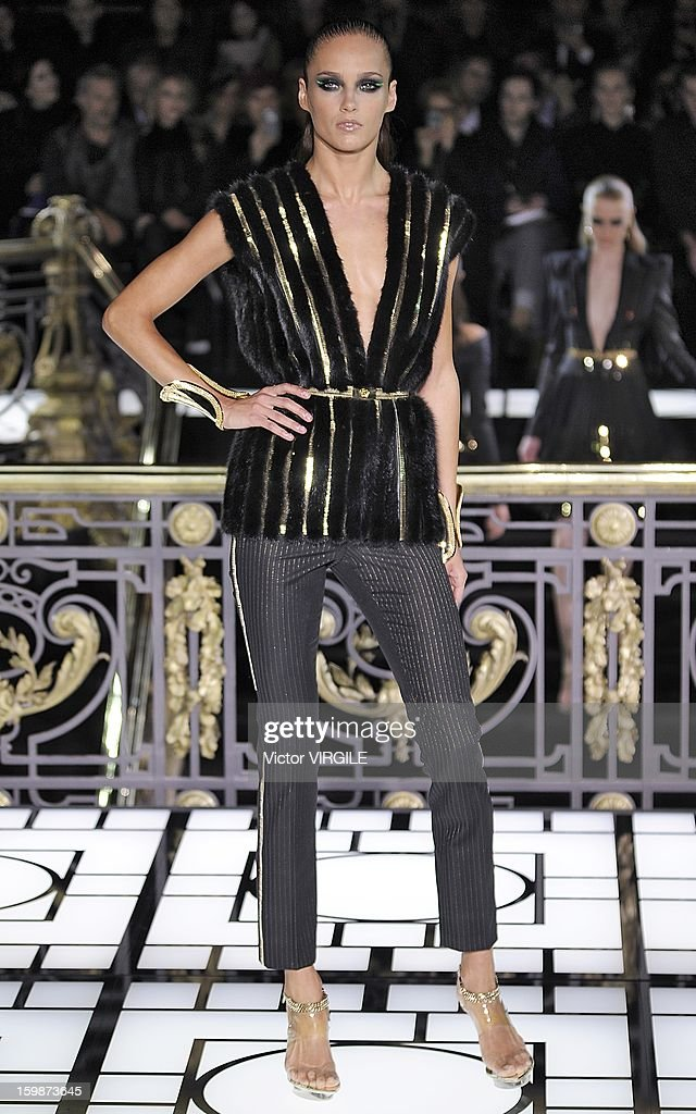 Karmen Pedaru walks the runway during the Atelier Versace Spring/Summer 2013 Haute-Couture show as part of Paris Fashion Week at Le Centorial on January 20, 2013 in Paris, France.