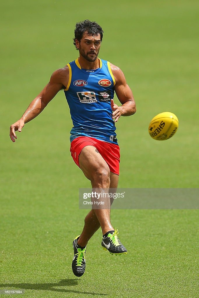 <a gi-track='captionPersonalityLinkClicked' href=/galleries/search?phrase=Karmichael+Hunt&family=editorial&specificpeople=162731 ng-click='$event.stopPropagation()'>Karmichael Hunt</a> kicks during a Gold Coast Suns AFL training session at Metricon Stadium on February 20, 2013 in Gold Coast, Australia.