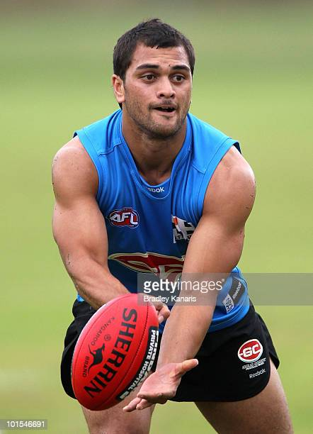 Karmichael Hunt of the Gold Coast Football Club hand passes during a Gold Coast Football Club training session on June 2 2010 in Gold Coast Australia