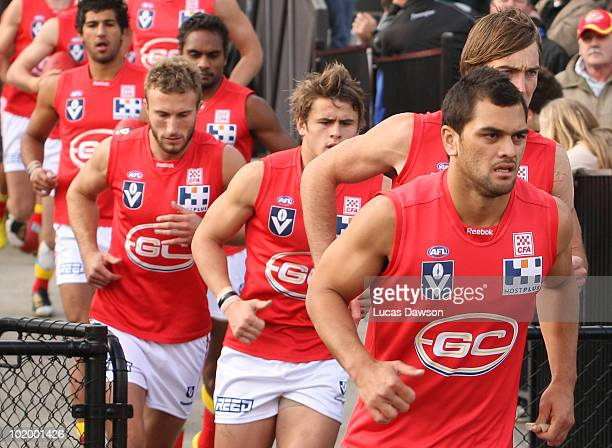 Karmichael Hunt of the Gold Coast runs on to the field during the round nine VFL match between the Coburg Tigers and the Gold Coast at Highgate...