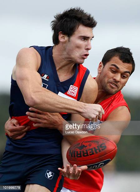 Karmichael Hunt of the Gold Coast tackles David Gourdis of the Tigers during the round nine VFL match between the Coburg Tigers and the Gold Coast at...