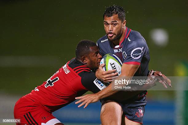 Karmichael Hunt of the Reds is tackled during the Super Rugby preseason match between the Reds and the Crusaders at Ballymore Stadium on February 6...