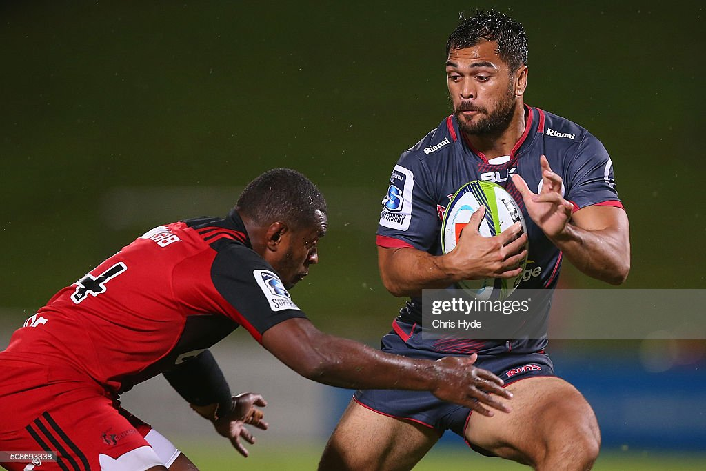 <a gi-track='captionPersonalityLinkClicked' href=/galleries/search?phrase=Karmichael+Hunt&family=editorial&specificpeople=162731 ng-click='$event.stopPropagation()'>Karmichael Hunt</a> of the Reds is tackled during the Super Rugby pre-season match between the Reds and the Crusaders at Ballymore Stadium on February 6, 2016 in Brisbane, Australia.