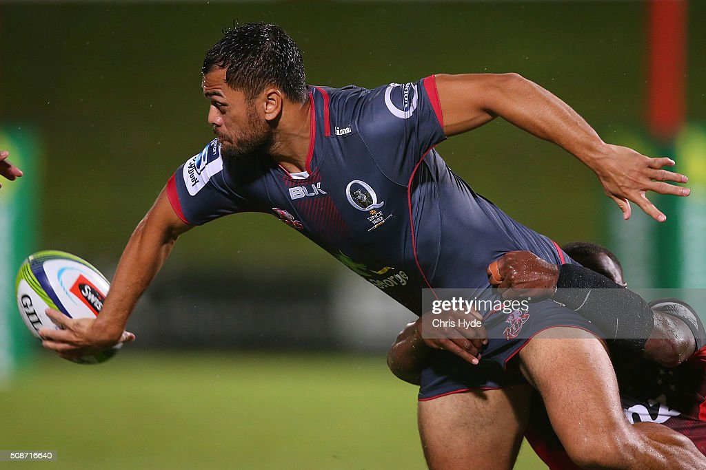 <a gi-track='captionPersonalityLinkClicked' href=/galleries/search?phrase=Karmichael+Hunt&family=editorial&specificpeople=162731 ng-click='$event.stopPropagation()'>Karmichael Hunt</a> of the Reds passes while tackled during the Super Rugby pre-season match between the Reds and the Crusaders at Ballymore Stadium on February 6, 2016 in Brisbane, Australia.