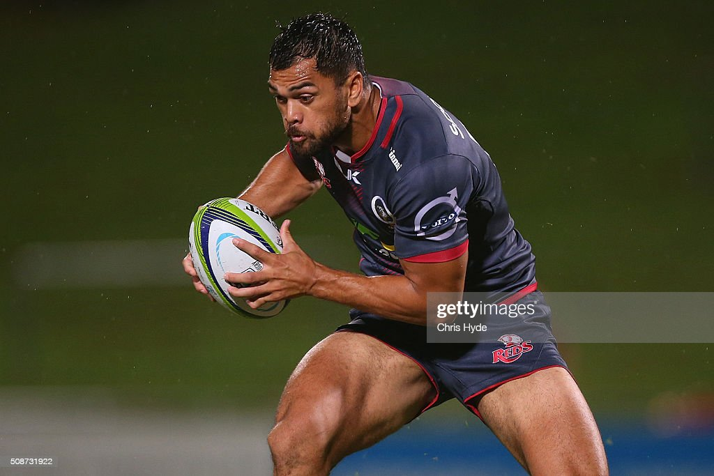 Karmichael Hunt of the Reds runs the ball during the Super Rugby pre-season match between the Reds and the Crusaders at Ballymore Stadium on February 6, 2016 in Brisbane, Australia.