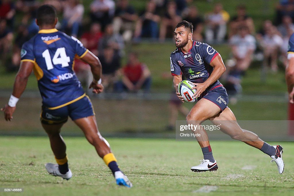 <a gi-track='captionPersonalityLinkClicked' href=/galleries/search?phrase=Karmichael+Hunt&family=editorial&specificpeople=162731 ng-click='$event.stopPropagation()'>Karmichael Hunt</a> of the Reds runs the ball during the Super Rugby Pre-Season match between the Reds and the Brumbies at Ballymore Stadium on February 12, 2016 in Brisbane, Australia.