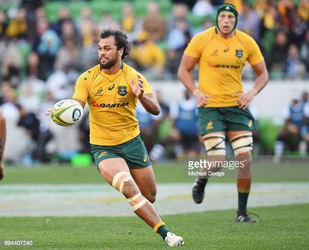 Karmichael Hunt of the Wallabies passes the ball during the International Test match between the Australian Wallabies and Fiji at AAMI Park on June...