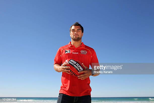 Karmichael Hunt poses to the media during the GCFC AFL Press conference at the North Burleigh Surf Life Saving Club on May 31 2010 in Gold Coast...