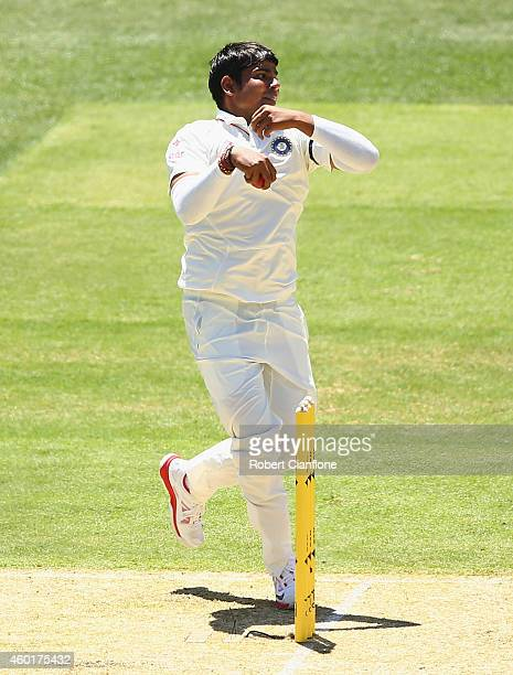 Karn Sharma of India bowls during day one of the First Test match between Australia and India at Adelaide Oval on December 9 2014 in Adelaide...