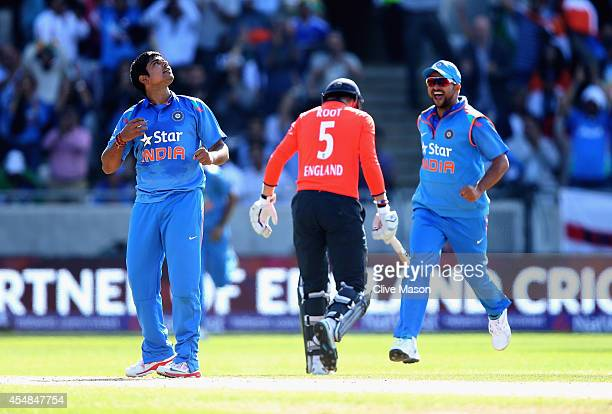 Karn Sharma of India celebrates dismissing Joe Root of England during the NatWest International T20 2014 match between England and India at Edgbaston...
