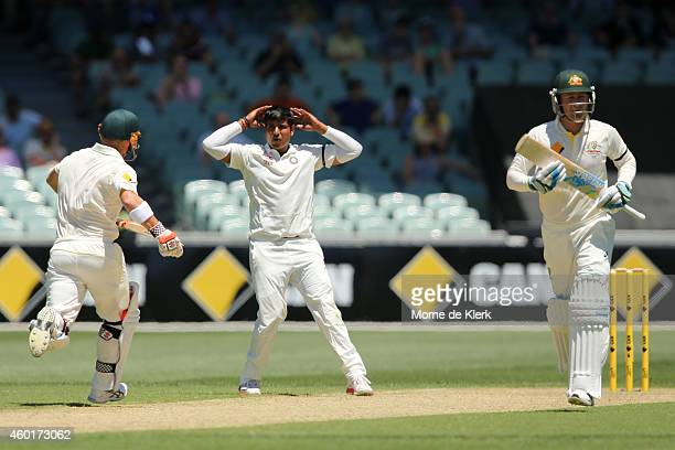 Karn Sharma of India reacts as Australian players take a run from his bowling during day one of the First Test match between Australia and India at...