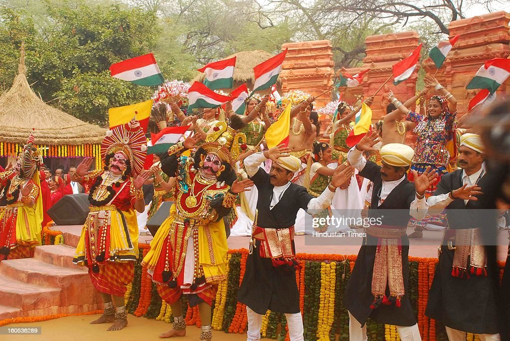 Karnataka artists perform their folk dance on the 'choupal' during the inauguration of 27th Surajkund International Crafts Mela on February 2, 2013 at Surajkund Near Faridabad, India.
