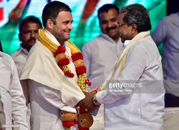 Karnataka Chief Minister Siddaramaiah felicitates Congress Vice President Rahul Gandhi during party delegate meeting at Jnana Jyoti Auditorium on...