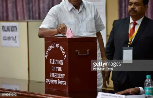 Karnataka MLA casting his vote for the Presidential election at Vidhan Sabha on July 17 2017 in Bengaluru India Approx 99% voting was recorded for...