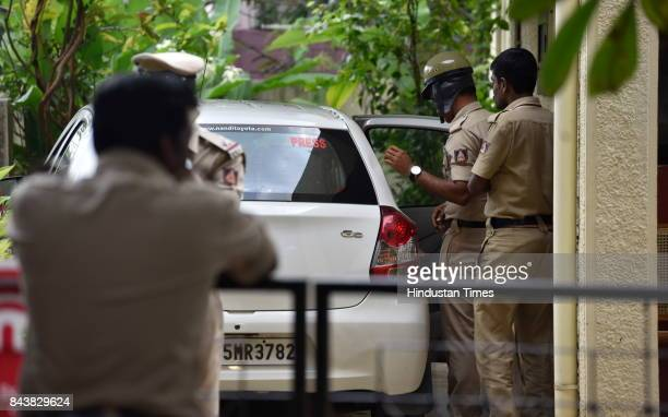 Karnataka Police seen using the car of the slain journalist Gauri Lankesh for resting at her RR Nagar residence on September 7 2017 in Bengaluru...