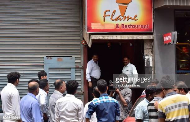 Karnataka State Excise sealing a pub on Brigade road on July 1 2017 in Bengaluru India As per the Supreme court guidelines liquors cant be sold...