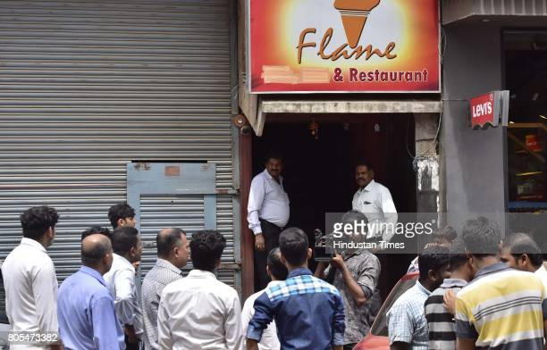 Karnataka State Excise sealing a pub on Brigade Road on July 1 2017 in Bengaluru India As per the Supreme Court guidelines liquors can't be sold...