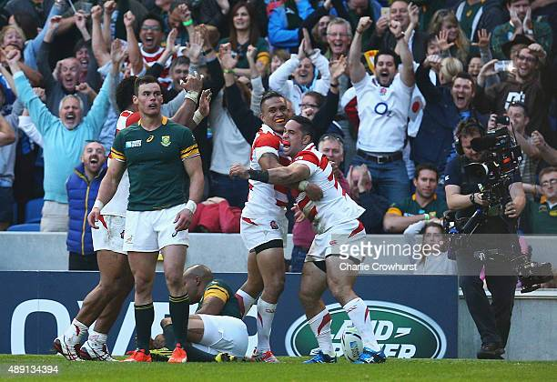 Karne Hesketh of Japan celebrates scoring the winning try during the 2015 Rugby World Cup Pool B match between South Africa and Japan at the Brighton...