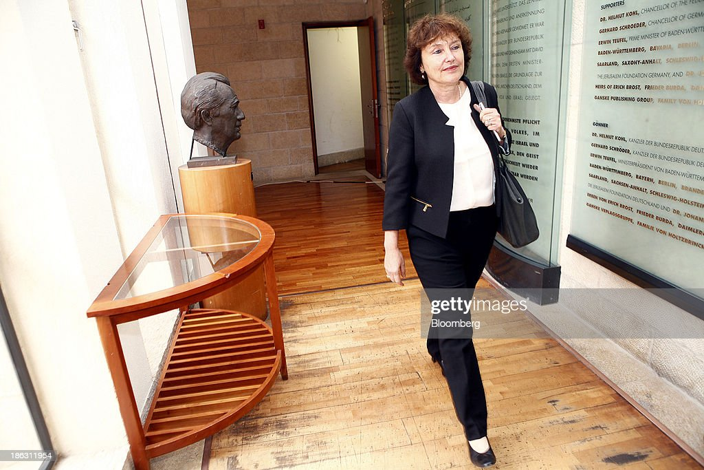 Karnit Flug, governor of the Bank of Israel, arrives for a roundtable on social economic policy at the 'Causes and Consequences of Inequality' conference organised by the Taub Center in Jerusalem, Israel, on Wednesday, Oct. 30, 2013. Flug and Prime Minister Benjamin Netanyahu said it is essential to integrate more Israeli Arabs and ultra-Orthodox men into the labor force to sustain economic growth and improve standards of living. Photographer: Ariel Jerozolimski/Bloomberg via Getty Images
