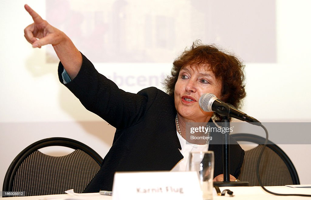 Karnit Flug, governor of the Bank of Israel, gestures whilst speaking during a roundtable on social economic policy at the 'Causes and Consequences of Inequality' conference organised by the Taub Center in Jerusalem, Israel, on Wednesday, Oct. 30, 2013. Flug and Prime Minister Benjamin Netanyahu said it is essential to integrate more Israeli Arabs and ultra-Orthodox men into the labor force to sustain economic growth and improve standards of living. Photographer: Ariel Jerozolimski/Bloomberg via Getty Images