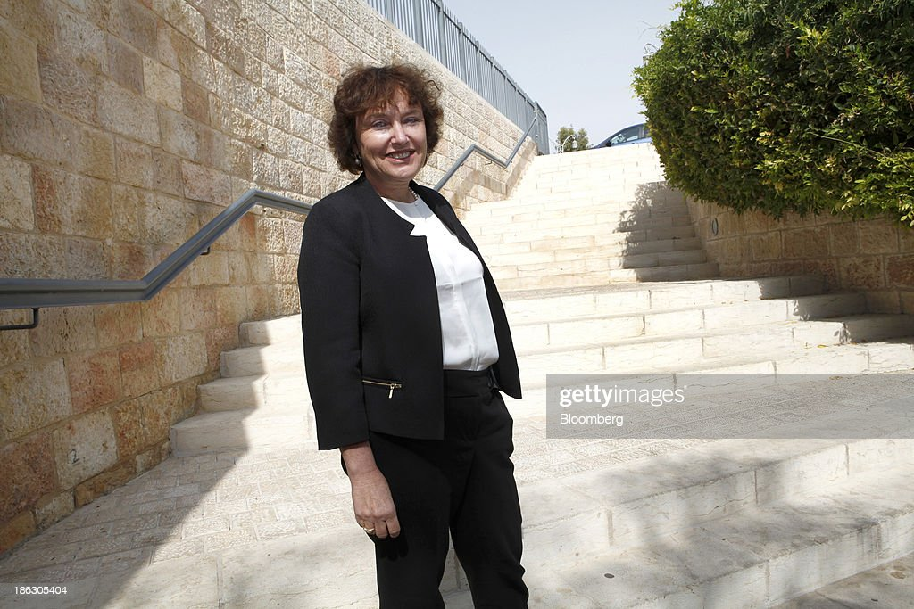 Karnit Flug, governor of the Bank of Israel, poses for a photograph before attending a roundtable on social economic policy at the 'Causes and Consequences of Inequality' conference organised by the Taub Center in Jerusalem, Israel, on Wednesday, Oct. 30, 2013. Flug and Prime Minister Benjamin Netanyahu said it is essential to integrate more Israeli Arabs and ultra-Orthodox men into the labor force to sustain economic growth and improve standards of living. Photographer: Ariel Jerozolimski/Bloomberg via Getty Images