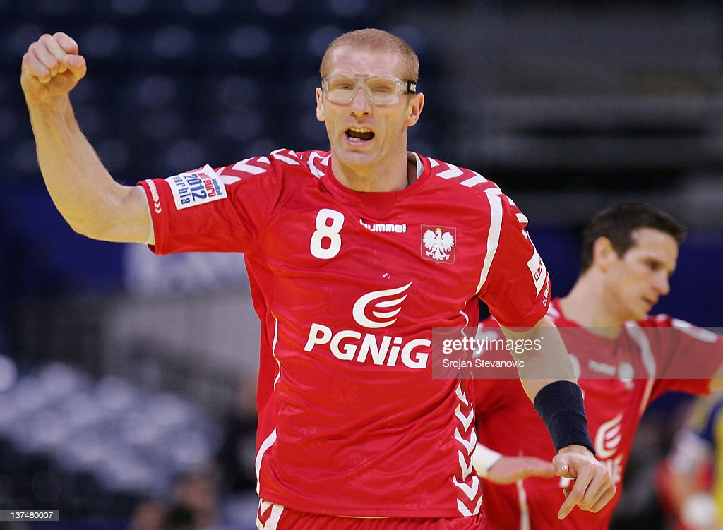 <a gi-track='captionPersonalityLinkClicked' href=/galleries/search?phrase=Karol+Bielecki&family=editorial&specificpeople=786154 ng-click='$event.stopPropagation()'>Karol Bielecki</a> of Poland celebrates scoring during the Men's European Handball Championship 2012 main group 1 match between Poland and Sweden, at Belgrade Arena Hall on January 21, 2011 in Belgrade, Serbia.