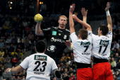 Karol Bielecki of RheinNeckar Loewen is challenged by Nenad Vuckovic Thomas Klitgaard and Felix Danner of Melsungen during the Toyota Handball...