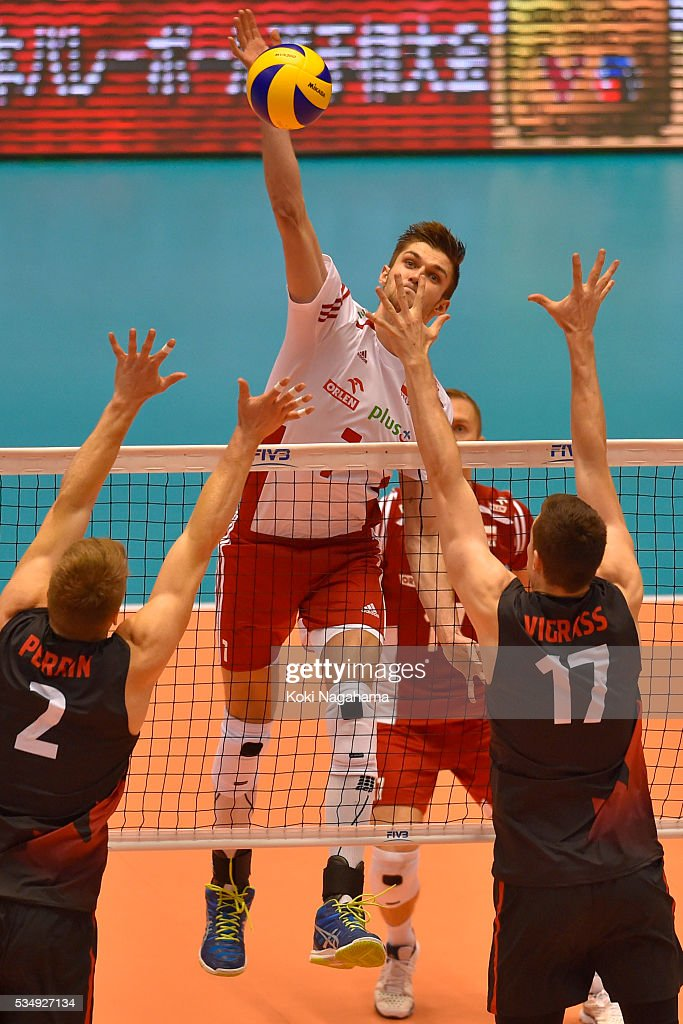 Karol Klos #7 of Poland spikes the ball during the Men's World Olympic Qualification game between Poland and Canada at Tokyo Metropolitan Gymnasium on May 28, 2016 in Tokyo, Japan.