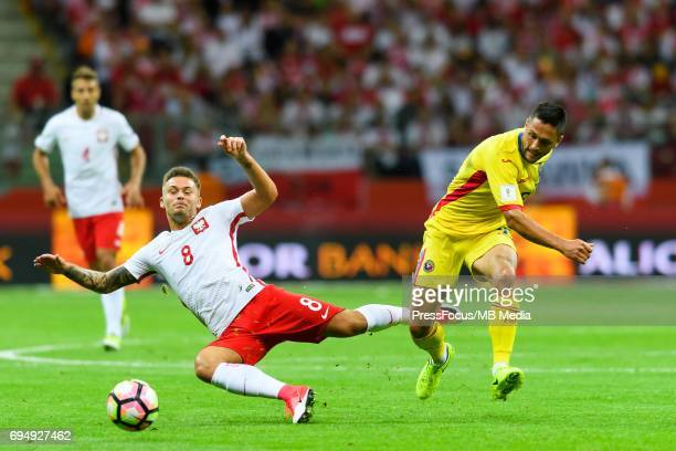 Karol Linetty and Florin Andone during World Cup 2018 qualifier between Poland and Romania on June 10 2017 in Warsaw Poland'n
